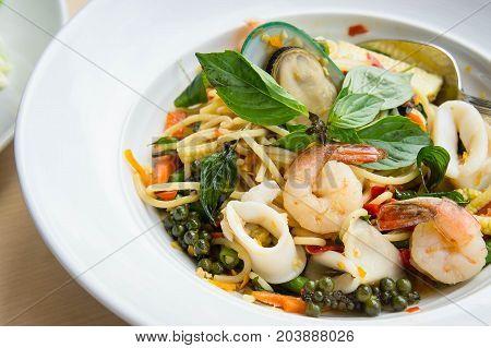 Spaghetti Sea food Drunkard Spicy delicious Thai food on white dish