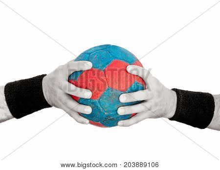 Man's hands on blue and red handball isolated on white colored handball and desaturated hands