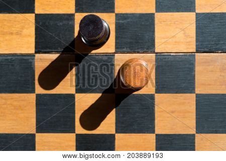 top view Chess Rooks stand on chessboard with shadows