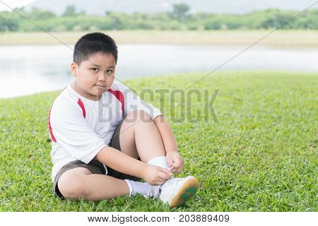 Obese Fat Asian Boy Lacing Sport Shoe.