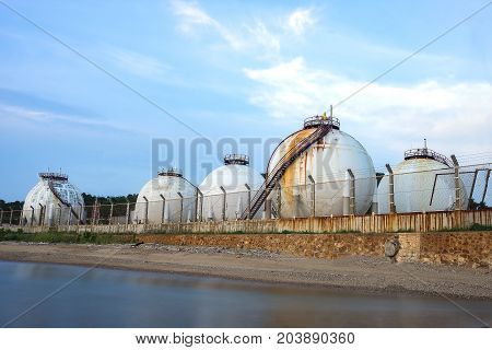 Natural gas tank in the petrochemical industryOil and gas industry - Petrochemical factory Industrial zone and petrochemical plant at sunset