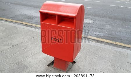 red postbox on street in republic of Korea