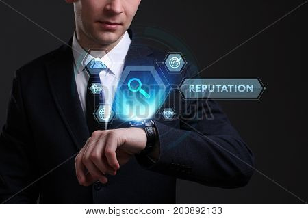 Business Technology Internet and network concept. Young businessman working on a virtual screen of the future and sees the inscription: Reputation