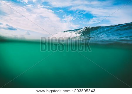 Crashing turquoise wave in Bali, Kuta. Crystal wave in ocean
