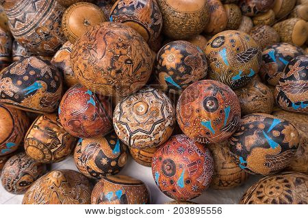April 29 2017 Otavalo Ecuador: indigenous quechua crafts made of coconut shell selling on the street in the Saturday market