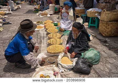 April 29 2017 Otavalo Ecuador: indigenous quechua people selling produce from the ground on the street in the Saturday market
