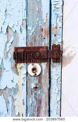 Rusty Metal Latch Lock On Textured Wooden Door Of An Old Barn. As Backdrop For Any Project.