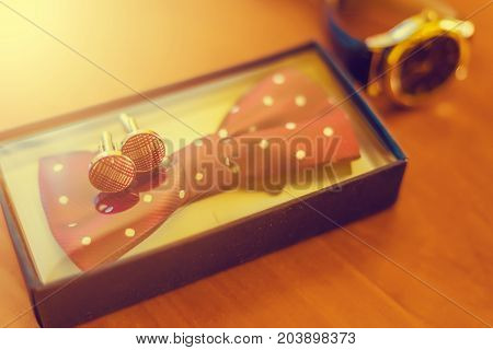 Groom's Morning. Classic Wedding Men's Accessories - Watches, Color Bow And Cufflinks On Wooden Tabl