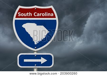 Road trip to South Carolina Red white and blue interstate highway road sign with word South Carolina and map of South Carolina with stormy sky background 3D Illustration