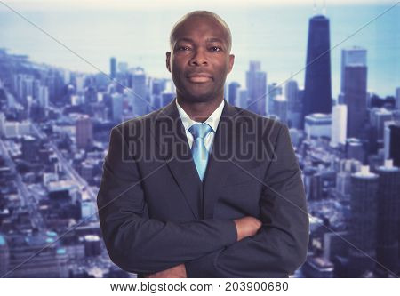 Serious african american businessman with skyline with skyline of city in background
