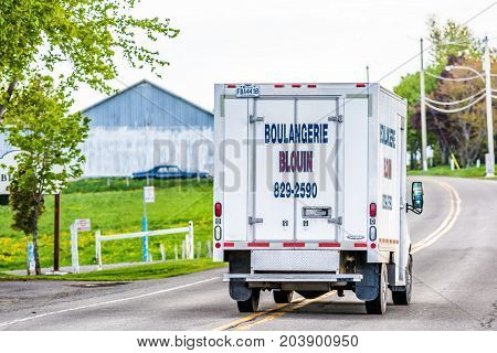 Ile D'Orleans Canada - June 1 2017: Boulangerie sign on truck on road carrying local bakery goods in small village or town