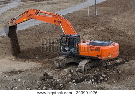 Excavator digging construction work. Construction and construction equipment. Excavation work