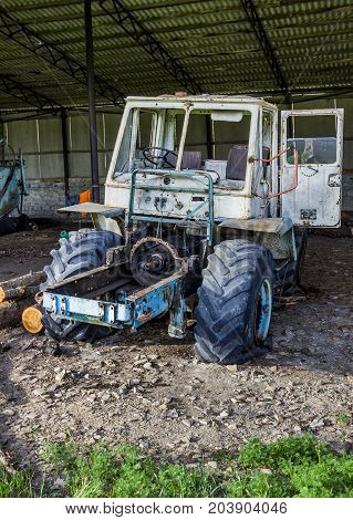 old rusty abandoned tractor made in USSR