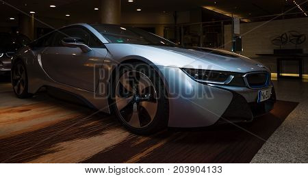BERLIN - NOVEMBER 28 2014: Showroom. The BMW i8 first introduced as the BMW Concept Vision Efficient Dynamics is a plug-in hybrid sports car developed by BMW