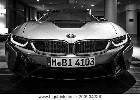 BERLIN - NOVEMBER 28 2014: Showroom. The BMW i8 first introduced as the BMW Concept Vision Efficient Dynamics is a plug-in hybrid sports car developed by BMW. Black and white