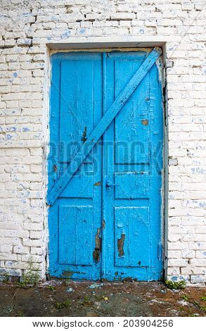 the old closed door painted at blue