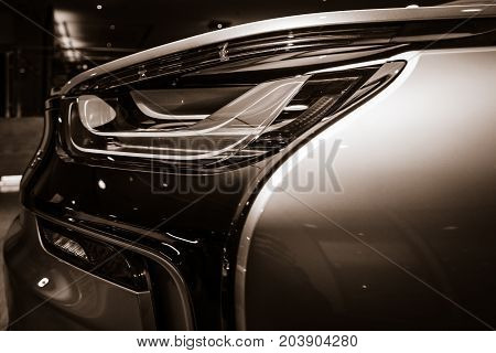 BERLIN - NOVEMBER 28 2014: Showroom. The rear lights of the car BMW i8 first introduced as the BMW Concept Vision Efficient Dynamics is a plug-in hybrid sports car developed by BMW. Toning
