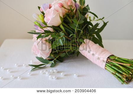 gentle pink bouquet of the bride stands on the table