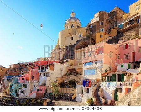 Panoramic view of the village of the fishermen's houses of Marina di Corricella with the church of San Rocco. Isola di Procida Italy.
