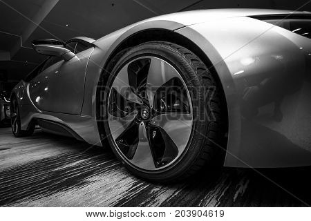 BERLIN - NOVEMBER 28 2014: Showroom. The BMW i8 first introduced as the BMW Concept Vision Efficient Dynamics is a plug-in hybrid sports car developed by BMW. Black and white.