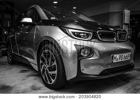 BERLIN - NOVEMBER 28 2014: Showroom. The BMW i3 previously Mega City Vehicle (MCV) is a five-door urban electric car developed by the German manufacturer BMW. Black and white.