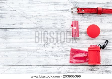 pet care and red grooming tools with collar on white wooden table background top view space for text