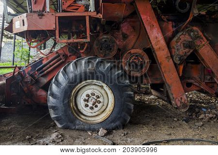 close-up wheel and details of old rusty combine harvester