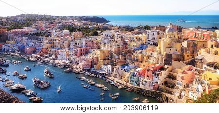 Panoramic view of the old village of fishermen's houses and the marina of Corricella a classic panoramic view of the island of Procida Italy.
