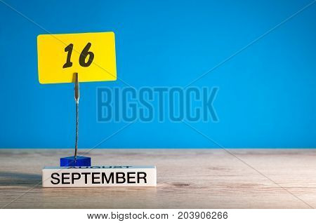 September 16th. Day 16 of month, Calendar on teacher or student, pupil table with empty space for text, copy space.