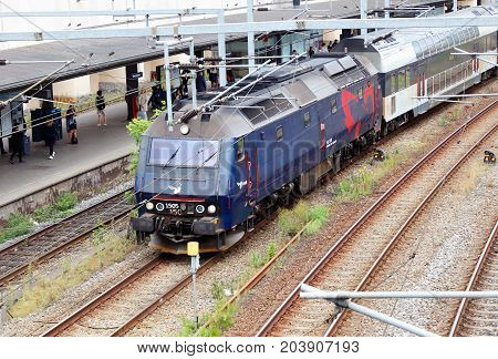 Copenhagen Denmark - August 24 2017: A passenger train with a blue DSB class ME diesel-electric locomotive at the front at the Vestport railroad station.
