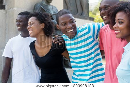 Group of relaxing african american man and woman in the city outdoor in the summer