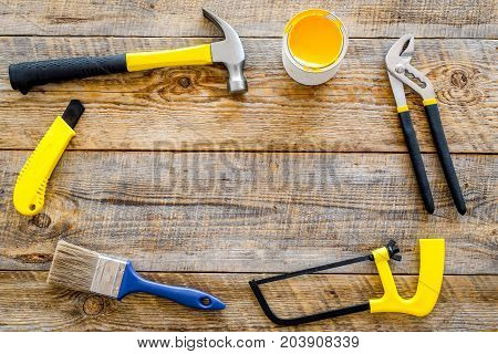 house-painter desk with set of building implements on wooden desk background top view mock up