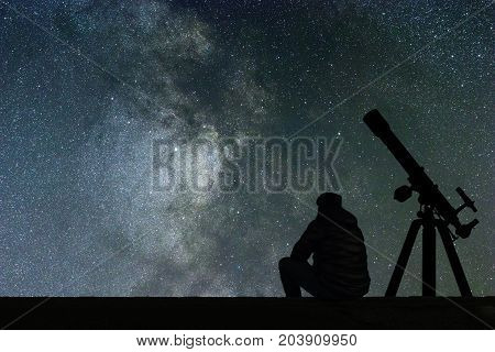 Man Looking At The Stars, Astronomy Telescope. Milky Way Starry Sky