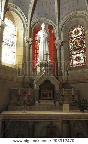 Saint-Laurent-sur-Sevre France - September 10 2019: Figure in the Basilica of St. Louis de Montfort is Roman Catholic basilica at Saint-Laurent-sur-Sevre France.