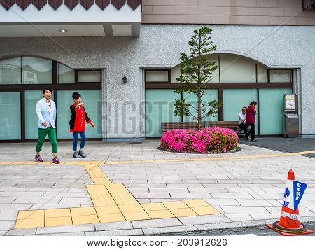KYOTO, JAPAN - JULY 05, 2017: Unidentified people walking at the streets of Kyoto, Japan