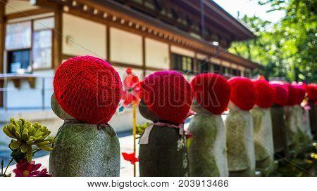 TOKYO, JAPAN - AUGUST 5 2017: Jizo Boddhisattvas at Zojo Buddhist Temple at Tokyo, Japan. Jizo Bodhisattva is the patron saint of thechildren's soul according to the Japanese mythology.