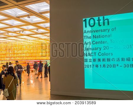 TOKYO, JAPAN - AUGUST 5 2017: Advice in the wall and a beautiful view of a forest numbers inside of the museum with an assorted and colorful pieces of numbers, with the paper numbers ranging from 0 to 9 hung in a grid-like formation at National Art Museum