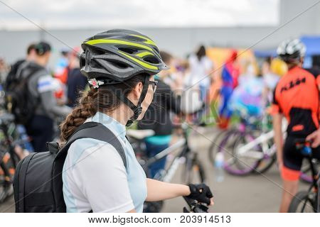 woman with bicycle at bicycle parade , portrait