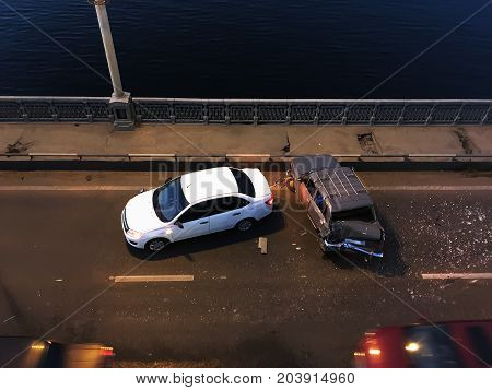 Crash or auto accident on the bridge, collision of two cars, top view