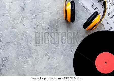 Desk of musician for songwriter work set with vynil record on stone background top view mockup