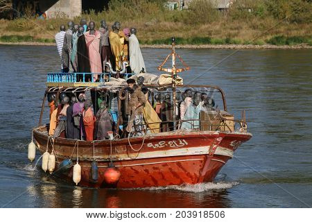 MAGDEBURG, GERMANY - September 12, 2017. The refugee boat Al-hadi Djumaa arrives Magdeburg. In summer of 2013, 200 people came from Africa to Europe by this boat. Now it is part of an art project.