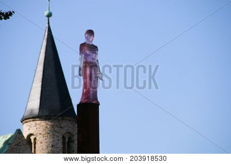 MAGDEBURG, GERMANY - September 12, 2017: The glass plastic Mechthild of Magdeburg with the tower of the convent UNSER LIEBEN FRAUEN in the background.