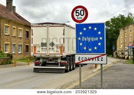 Truck crossing a border sign of European Union member Belgium.