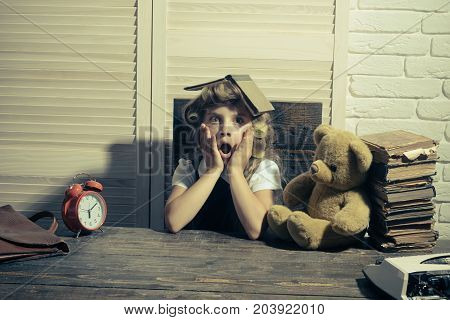 Little baby secretary with bear and book. Kid choose career and typing. Small girl with curler in hair. Child with briefcase and alarm clock. Education and childhood.