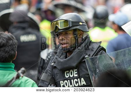 June 24 2017 Cotacachi Ecuador: riot police in the middle of an altercation during the Inti Raymi parade