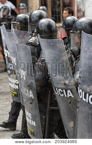 June 24 2017 Cotacachi Ecuador: riot police behind shields during the Inti Raymi parade