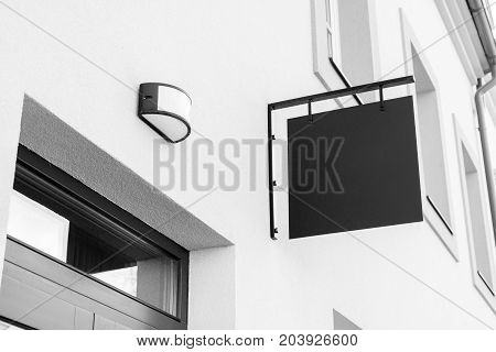 Black and white picture of empty outdoor business signage mockup to add company logo