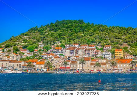 Seafront view at picturesque ancient village on Island Vis, summertime in Croatia, Europe.