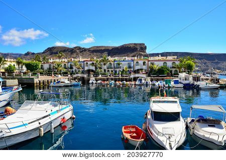 Port and promenade of beautiful romantic picturesque village Puerto de Mogan on Gran Canaria.