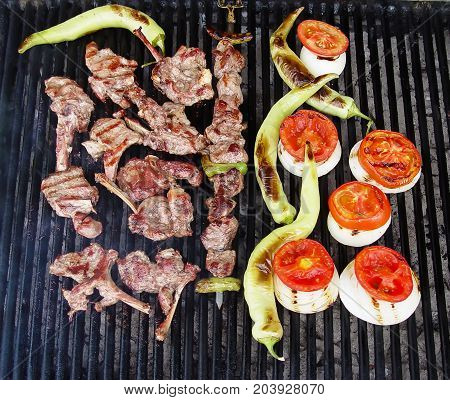 Meat and vegetables cooked on the grill. Turkish cuisine